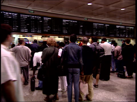 september 25 2001 ws commuters in line at penn station / new york city new york united states - long island railroad stock videos & royalty-free footage