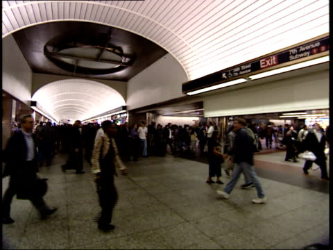 september 25 2001 pan commuters walking through penn station / new york city new york united states - long island railroad stock videos & royalty-free footage