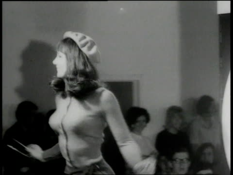 september 26 1966 montage models dancing on carnaby street to rock roll as audience is tapping feet / carnaby street london united kingdom - 1966 stock videos & royalty-free footage