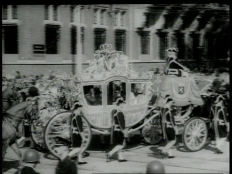 september 26 1966 montage queen juliana riding to parliament for opening in golden coach accompanied by her husband and daughters / the hague... - carriage stock videos & royalty-free footage