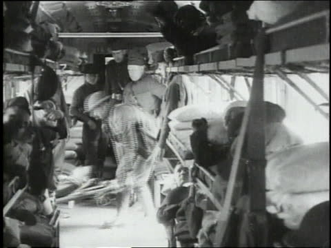 september 29, 1918 from inside the train, soldiers bringing the wounded on stretchers onboard / souilly, meuse, france - wounded stock videos & royalty-free footage