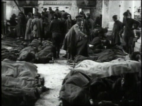 september 30, 1918 soldiers moving among wounded lying on floor of ruined church used by 110th sanitary train as hospital / neuvilly, france - 1918 stock videos & royalty-free footage