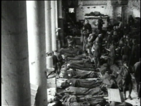 September 30 1918 WS Wounded lying on floor of ruined church used by 110th Sanitary Train as hospital / Neuvilly France