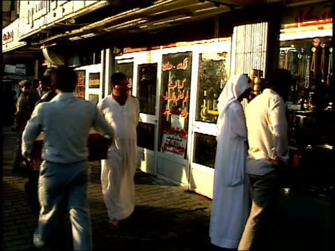 september 4 1990 ms pedestrians and shoppers on a busy city street / baghdad iraq - 1990 1999 stock videos & royalty-free footage