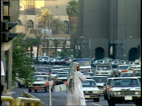 september 4 1990 ws pedestrians and vehicle traffic on a busy city street / baghdad iraq - 1990 1999 stock videos & royalty-free footage