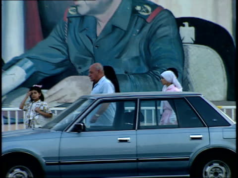 september 4 1990 ws pedestrians walking on a busy city street with billboard of saddam hussein in the background / baghdad iraq - 1990 1999 stock videos & royalty-free footage