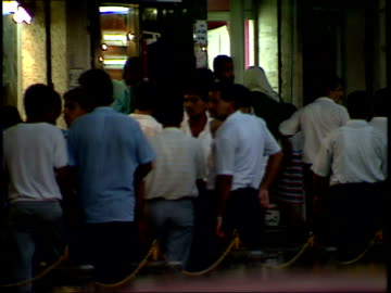 september 4, 1990 pedestrians walking on the sidewalk of a busy city street / baghdad, iraq - 1990 1999 stock videos & royalty-free footage
