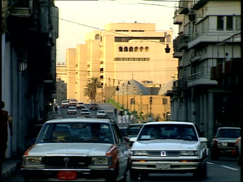 september 4 1990 zo vehicle and pedestrian traffic on a busy city street / baghdad iraq - 1990 1999 stock-videos und b-roll-filmmaterial