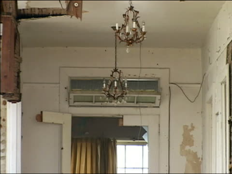 september 4 2005 close up zoom out from chandelier to ruined building after hurricane katrina / new orleans louisiana - れんが造りの家点の映像素材/bロール