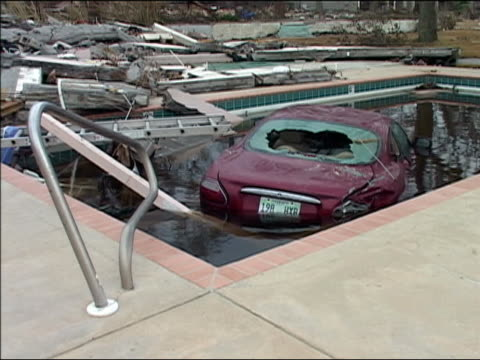 september 4 2005 medium shot car with broken back windshield submerged in pool after hurricane katrina / new orleans louisiana - 2005 stock videos and b-roll footage