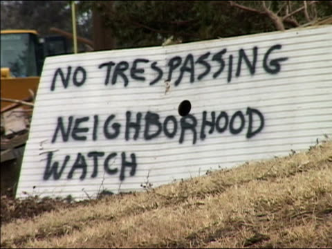 september 4, 2005 medium shot 'no trespassing. neighborhood watch' sign / hurricane katrina / new orleans, louisiana - no trespassing stock videos & royalty-free footage