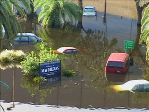 september 4 2005 wide shot cars submerged in standing water after hurricane katrina / new orleans louisiana - 2005 stock videos & royalty-free footage