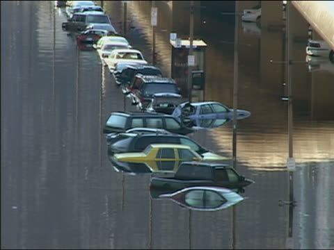 september 4 2005 wide shot line of cars submerged in floodwater after hurricane katrina / new orleans louisiana - 2005 stock videos & royalty-free footage