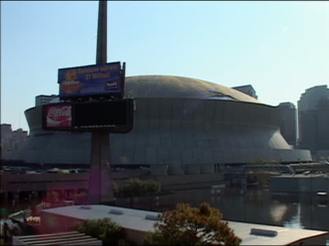 september 4 2005 wide shot louisiana superdome surrounded by standing water after hurricane katrina / new orleans louisiana - 2005 stock videos & royalty-free footage