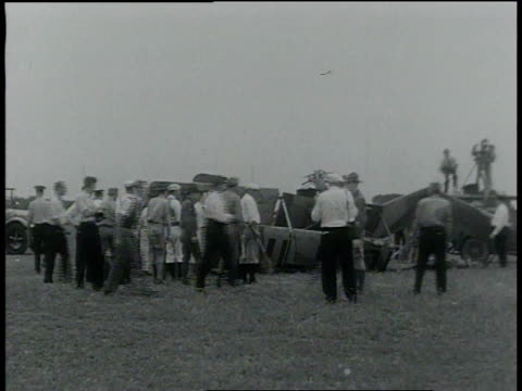 september 5, 1932 montage crowd runs to plane wreckage / cleveland, ohio, united states - 1932 stock videos & royalty-free footage