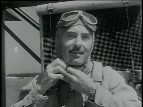 september 5 1932 montage man piloting an airplane and a gyrocopter lands / cleveland ohio united states - 1932 stock-videos und b-roll-filmmaterial