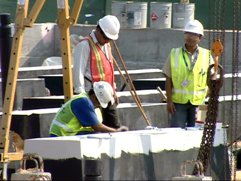 september 7, 2007 construction workers working on the 911 memorial at the pentagon / washington d.c., united states - the pentagon stock videos & royalty-free footage