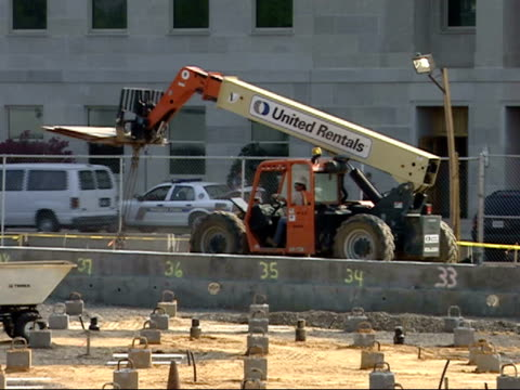 september 7, 2007 worker driving a frontloader during construction of the 9/11 memorial at the pentagon / washington d.c., united states - the pentagon stock videos & royalty-free footage