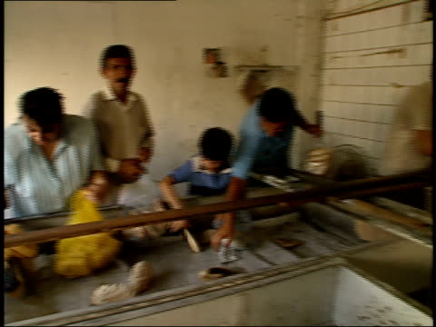 september 8 1986 pan customers scrambling for bread as baker tosses buns from brick oven to bin / baghdad iraq - iraq stock videos & royalty-free footage