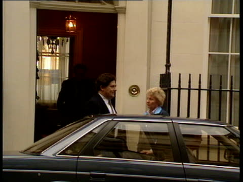 vídeos de stock e filmes b-roll de reactions a england london 11 downing st nigel lawson exits house and into car and away - setembro