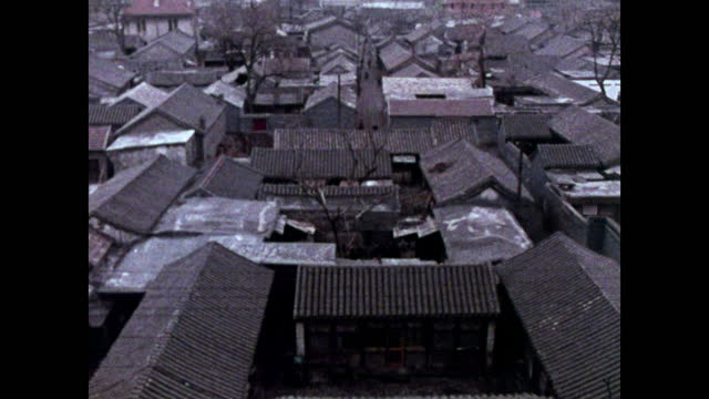 seq. bicycles riding beijing narrow hutong streets; 1973 - maoism stock videos & royalty-free footage