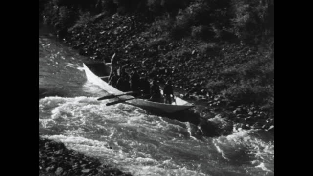 seq. has hozu rapids with tourboat in japan; 1964 - stone material stock videos & royalty-free footage
