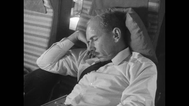 seq. male passenger sleeps on flight to tokyo; 1964 - balding stock videos & royalty-free footage