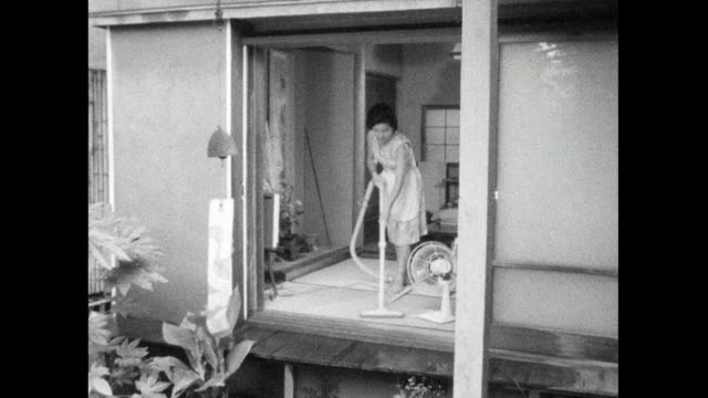 seq. of a woman cleaning and doing housework in japan; 1966 - showa period stock videos & royalty-free footage