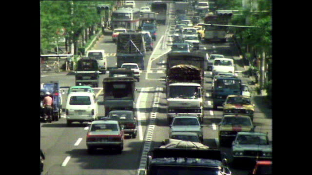 stockvideo's en b-roll-footage met seq. of busy city road and traffic jam in tokyo; 1981 - establishing shot