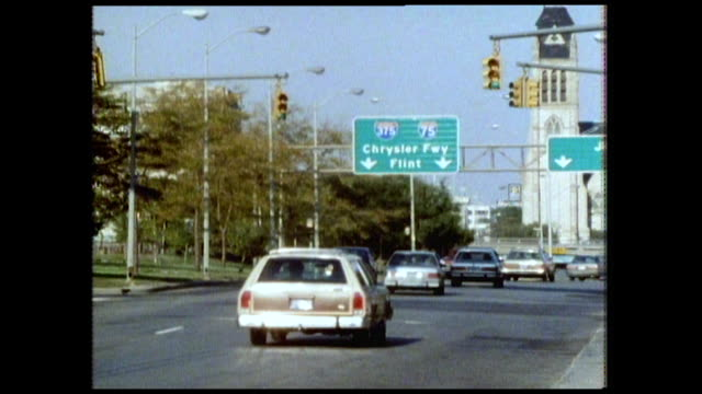 seq. of busy roads in detroit with traffic; 1986 - michigan stock videos & royalty-free footage