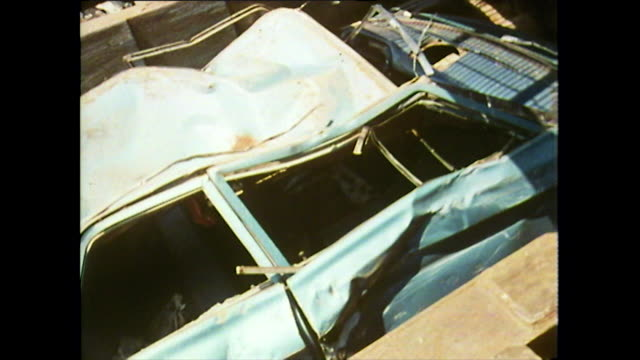 seq. of cars being destroyed in detroit scrapyard; 1972 - dismantling stock videos & royalty-free footage