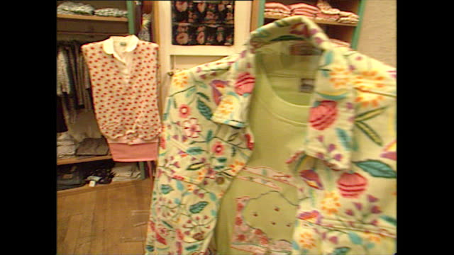 seq. of floral women's fashion in a clothes shop; 1992 - clothes shop stock videos & royalty-free footage