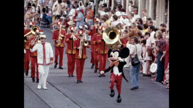 seq. of magic kingdom parade at disney world; 1980 - parade stock videos & royalty-free footage