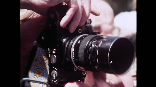 seq. of male press photographers taking pictures; 1981 - fame stock videos & royalty-free footage