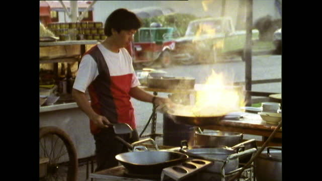 seq. of man cooking street food in chiang mai; 1989 - thailand stock videos & royalty-free footage