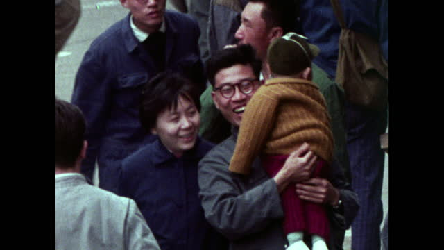 seq. of pedestrians walking along streets in shanghai; 1973 - two parents stock videos & royalty-free footage
