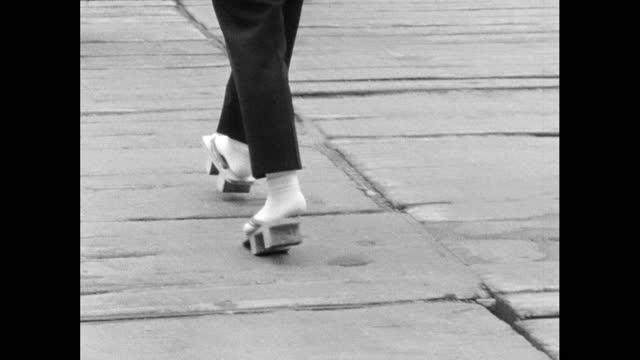 seq of woman walking in geta sandals; tokyo - footwear stock videos & royalty-free footage