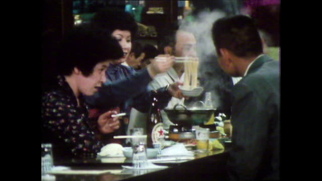 seq. people eating together in tokyo restaurant; 1981 - 1981 stock videos & royalty-free footage