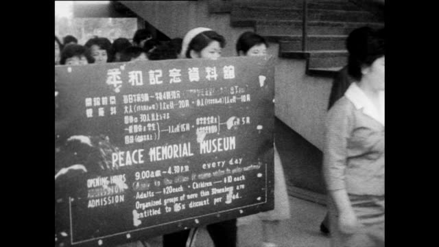 seq. showing hiroshima peace memorial museum; 1958 - information sign stock videos & royalty-free footage