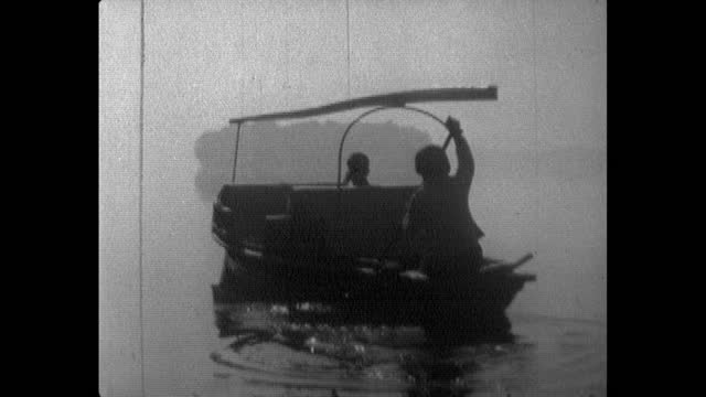 seq. small ferry boat being paddled on west lake, hangzhou; 1964 - paddel stock-videos und b-roll-filmmaterial