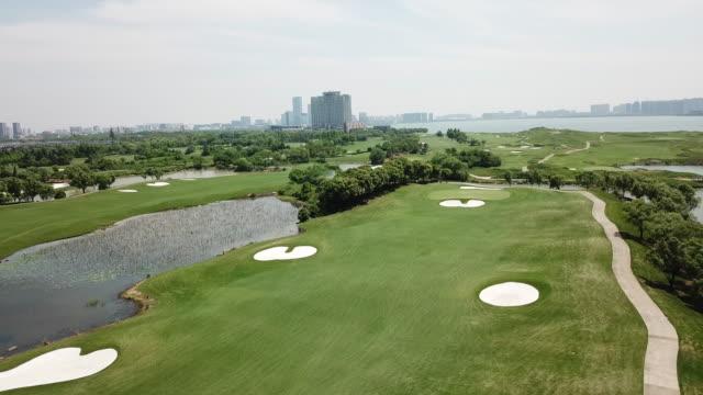 sequence across a golf course near suzhou, china - golfgreen bildbanksvideor och videomaterial från bakom kulisserna