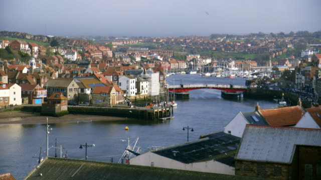 sequence across the town of whitby in north yorkshire. - yorkshire england stock videos & royalty-free footage