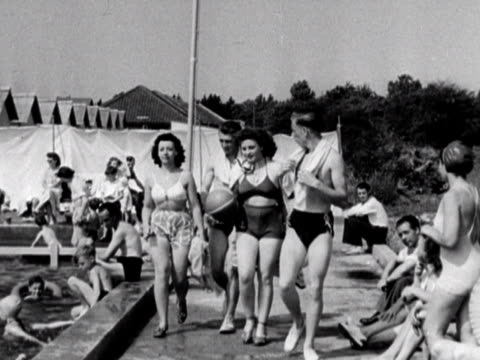 sequence around a swimming pool at the coronation holiday camp on hayling island. 1948. - holiday camp stock videos & royalty-free footage