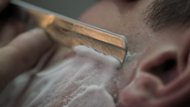 sequence barber shaving man's face - shaving stock videos & royalty-free footage
