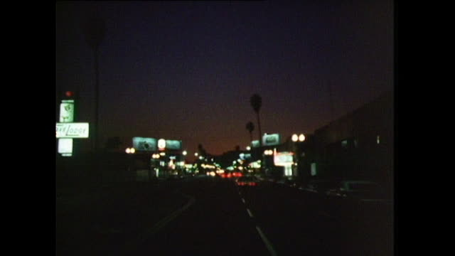 pov sequence driving through los angeles at night; 1972 - fade out stock videos & royalty-free footage