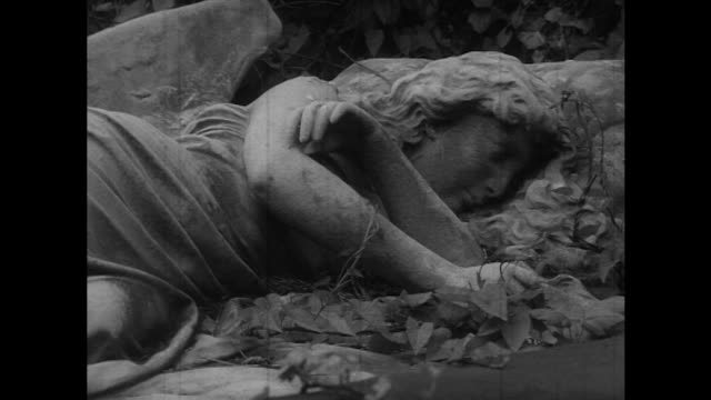 sequence focusing on various statues adorning crypts at highgate cemetery. - highgate stock videos & royalty-free footage