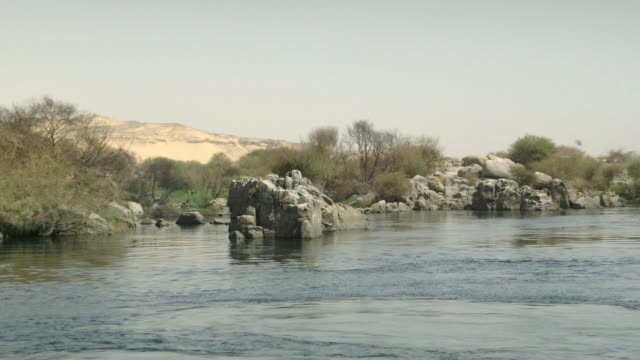POV sequence from a boat showing the banks of the River Nile, Egypt.