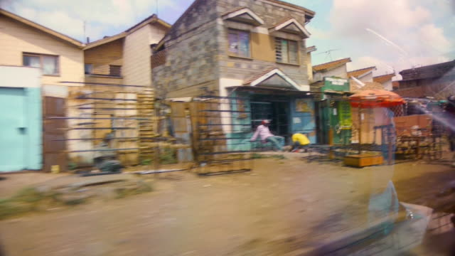 POV sequence from a car showing streets in Nairobi, Kenya.
