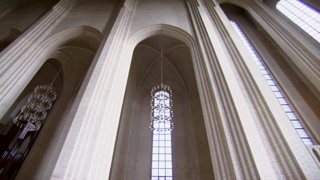 sequence highlighting the beautiful interior of the grundtvig's church in copenhagen, denmark. - religion bildbanksvideor och videomaterial från bakom kulisserna