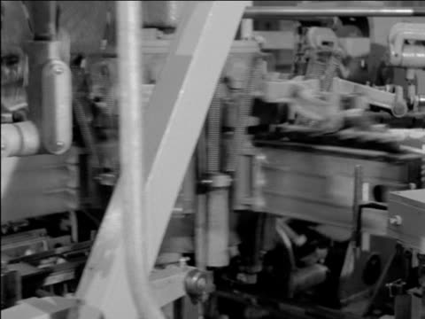 sequence in christie biscuit factory showing ritz crackers being packed in boxes on conveyors all moving at high speed ritz cracker factory on... - cracker stock videos and b-roll footage